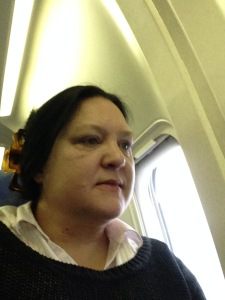 Me on the plane...talk about out of my comfort one...I hate flying. So yes I am biting my lip.