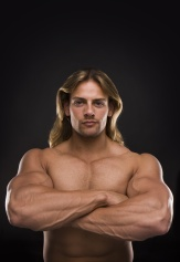 Sexy topless muscular man isolated on black